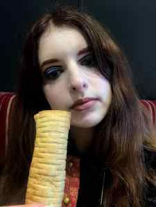 Angie with Greggs Vegan Sausage Roll
