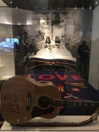 Bed In Bedspread and guitar